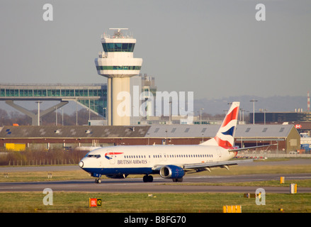 British Airways Boeing 737 436 taxing after landing at London Gatwick Airport. - Stock Photo