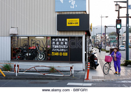 Fast motorcycle in the window of a shop called 'Motorcycle Slow Life' in Odawara, Japan - Stock Photo