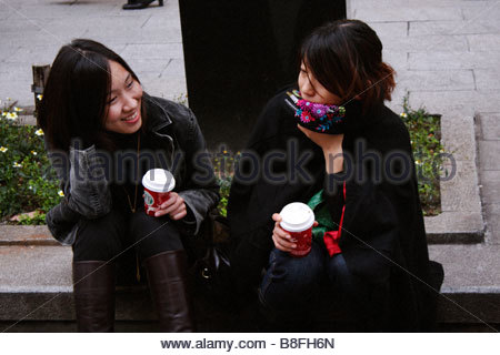 Two girls with coffee, Ginza, Tokyo Japan - Stock Photo