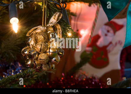 Close up on Golden Bells of a Rattle Decoration Hanging on Christmas Tree - Stock Photo