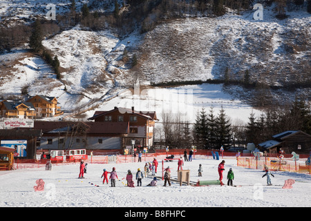 Rauris Austria Europe January Children learning on ski school nursery slopes in Alpine resort in Austrian Alps in - Stock Photo