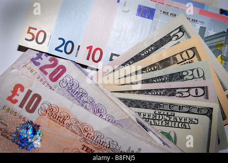 A stack of Euro, Dollar & Stirling bank notes / currency / money / cash - Stock Photo