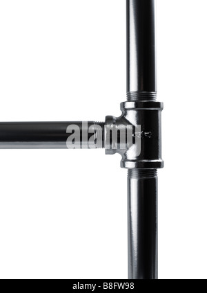 Studio shot of metal pipes and joint - Stock Photo
