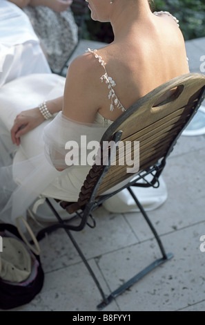 Bride sitting on a wooden Chair - Garden - Wedding