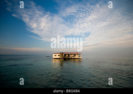 restaurant on stilts in Caribbean Sea Nicaragua after storm lacking bridge to structure destroyed access - Stock Photo