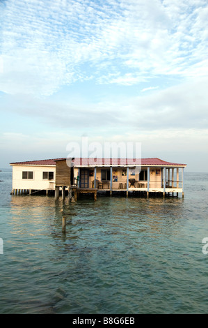 restaurant on stilts in Caribbean Sea Nicaragua after storm bridge to structure destroyed access - Stock Photo