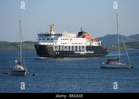 Clansman Caledonian MacBrayne ferry arriving Castlebay with sail boats isle of Barra Scotland  June 2007 - Stock Photo