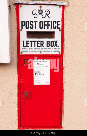 A red royal mail GR post office letter posting box in the uk - Stock Photo