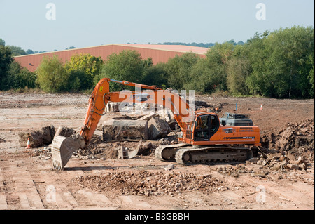 Orange Doosan DX340 tracked excavator working on a building site in england - Stock Photo