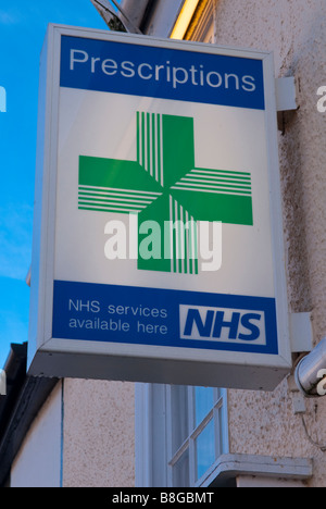 A sign outside a uk pharmacy advertising prescriptions and nhs services available here - Stock Photo