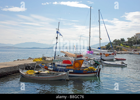 Kassiopi harbour, Corfu, with various boats tied to jetty - Stock Photo