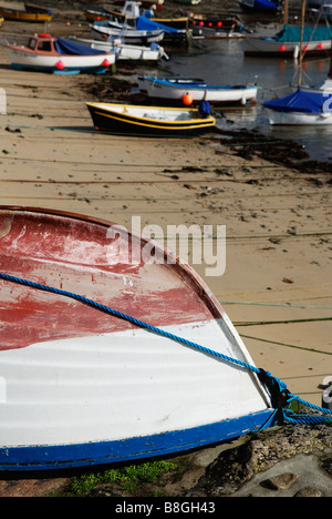 fishing boats in the harbour at mousehole,cornwall,uk - Stock Photo