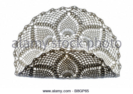 decorative doily made from lace partly folded - Stock Photo
