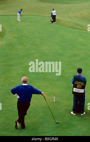 Golfers teeing off - Stock Photo