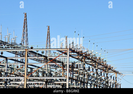 Electric power substation for transmission grid with switch tower circuit breakers switches and lightning rods - Stock Photo