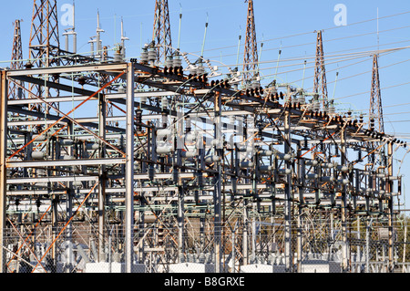 Electric power grid substation with switch towers transformers switches lines and lightning rods - Stock Photo