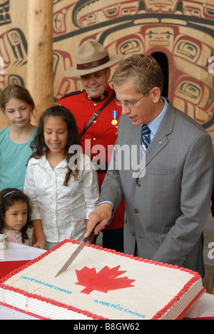 A crowd gathers around as Canada's birthday cake is cut at the Museum of Civilization in Hull, Quebec on July 1st - Stock Photo