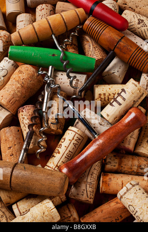 Assorted corkscrews and wine corks - Stock Photo