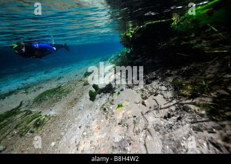 Diver enjoys underwater landscape of Sucuri river Bonito Mato Grosso do Sul Brazil - Stock Photo