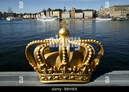 Gilded crown, Skeppsholmsbron, Stockholm, Sweden - Stock Photo