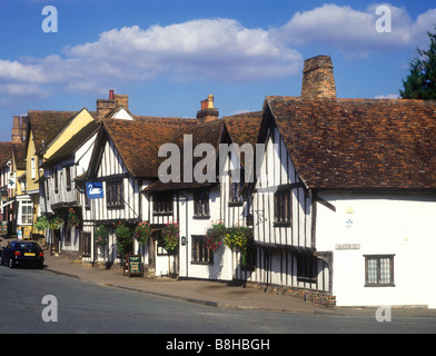 Street scene in the village of Lavenham showing the Swan Hotel, a medieval half-timbered building - Stock Photo