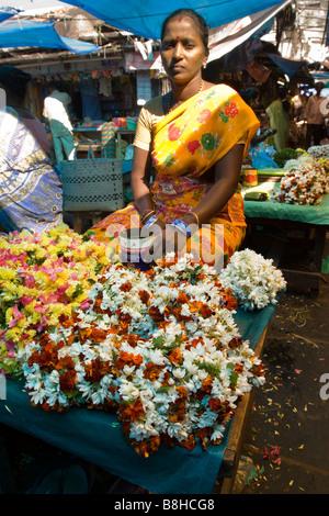 India Pondicherry Main Market stall selling fragrant jasmine floral garlands - Stock Photo