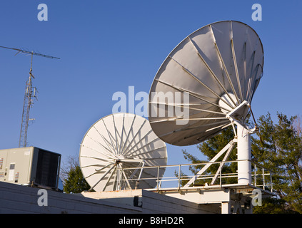 ARLINGTON VIRGINIA USA Satellite dish for cable TV on roof - Stock Photo
