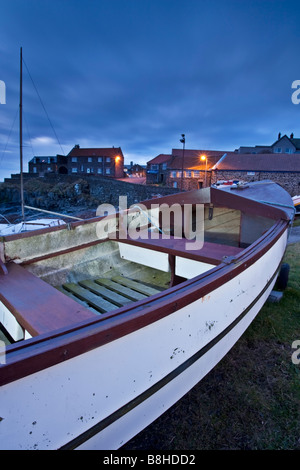 Fishing boats pulled up onto the harbour at Craster on the Northumbrian coast, Northumberland, England - Stock Photo