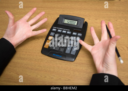 A person frustrated with figures and calculations - Stock Photo