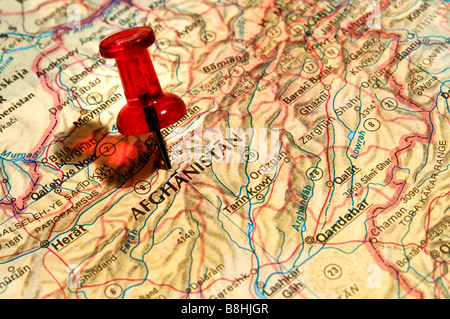 Red Pushpin on an atlas Afghanistan - Stock Photo