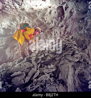 French geologist examining rock samples during the construction of the huge undersea Crossover on the Channel Tunnel - Stock Photo