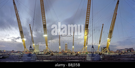 Like a giant spider's web, the cable net structure is raised during construction of the Millennium Dome/O2 Arena - Stock Photo