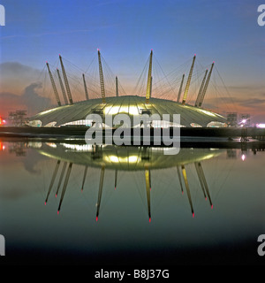 View of the completed structure of the Millennium Dome/O2 Arena in London reflected in the early morning sunrise. - Stock Photo