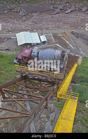 Conveyor system transporting materials and workers between upper and lower sites on a hydropower project in Ecuador. - Stock Photo