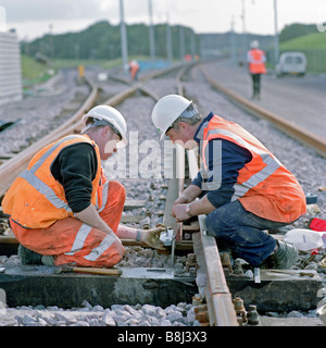 Contractors installing rail junction allowing access to depot supplying equipment and materials for the Channel - Stock Photo