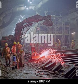 Channel Tunnel 8.36m diameter North Rail Boring Machine passes through the vast undersea UK crossover on its journey - Stock Photo