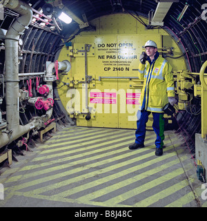 Eurotunnel engineer checking systems in an emergency cross passage between a Channel Tunnel rail tunnel and the - Stock Photo