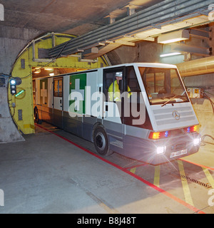 An STTS ambulance vehicle, specially designed for the Channel Tunnel, exits the service tunnel through an pressurised - Stock Photo