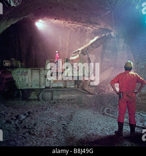 Roadheader excavating rock in the huge undersea UK Crossover on the Channel Tunnel project, 8kms from the English - Stock Photo