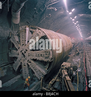 Channel Tunnel 8.36m diameter South Rail Boring Machine passes through the vast undersea UK crossover on its journey - Stock Photo
