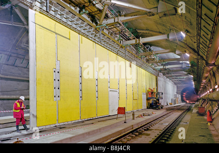 Installation of massive steel sliding doors used to separate rail tunnels in an undersea Crossover on the Channel - Stock Photo