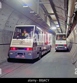 Two STTS vehicles, specially designed for the Channel Tunnel service tunnel, pass safely using a buried guidance - Stock Photo