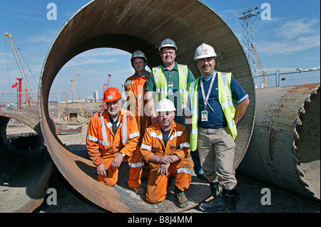 Construction is a collaborative short-term enterprise combining the skills and experience of groups of diverse individuals. - Stock Photo
