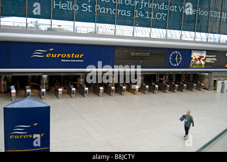a man walks across the deserted former eurostar terminal at waterloo station, london, shortly after services were - Stock Photo