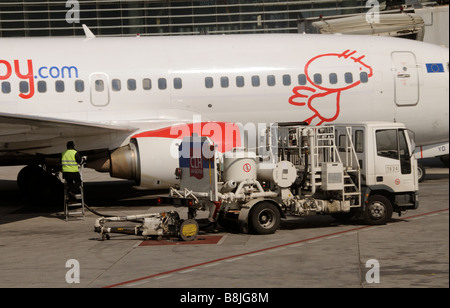 bmibaby Boeing 737 300 holiday jet being refuelled on the apron at  Malaga International Airport southern Spain - Stock Photo