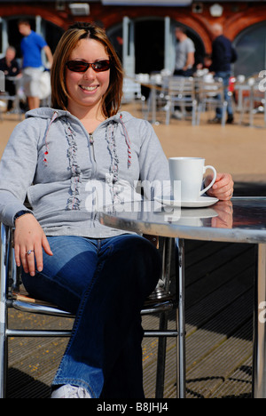 Beachside cafe on summers day at Brighton seafront UK - Stock Photo