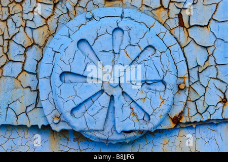 Closeup of blue painted ventilation slit on metal sheet covering with net of peeling off paint. - Stock Photo