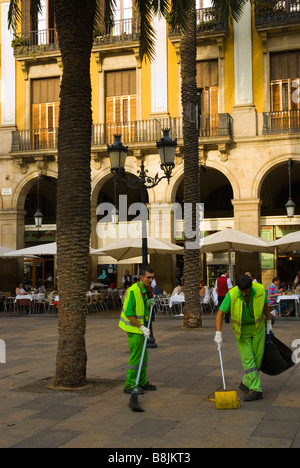 Street cleaners at Placa Reial square in Barri Gotic district of Barcelona Spain Europe - Stock Photo