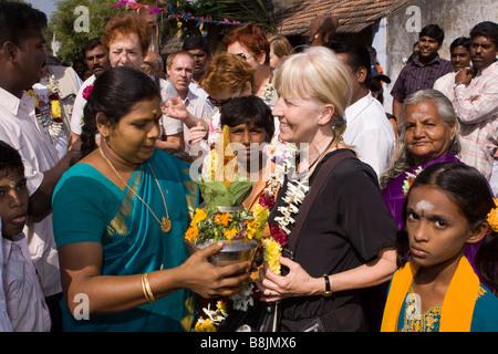 India Tamil Nadu Madurai Thiruchuli Village Pongal celebration villager welcoming tourists - Stock Photo