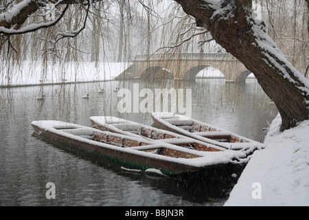 Snow on three 'Trinity College Punts' on the river cam, Cambridge. Heavy snow shower in January. - Stock Photo